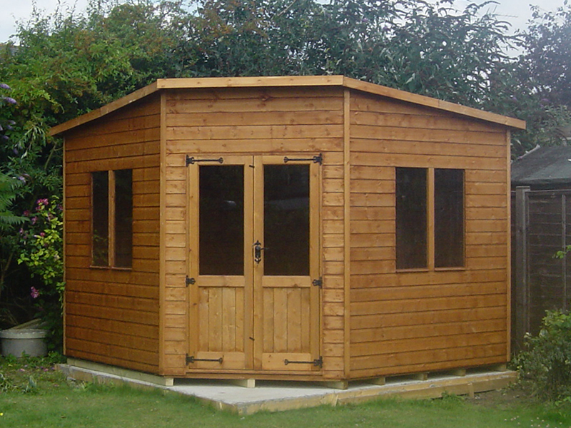 Corner cabin shed 8 x 8 surrey shed manufacturer for Garden shed 12x12